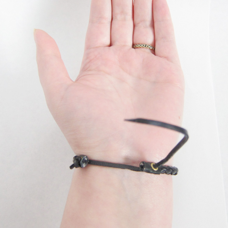 How to tie a celtic leather bracelet by yourself celtique creations slip the slightly pointed end under the bracelet to create a loop with the tail ccuart Image collections
